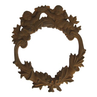 """Vintage Cast Iron """"Wreath"""" of Two Cherubs Holding a Crown Wall Hanging For Sale"""
