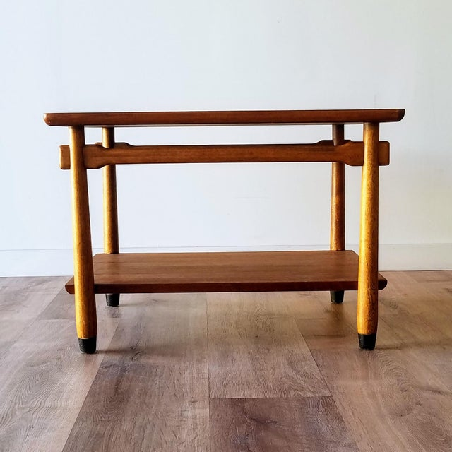 A 1960s two-tiered walnut side table with a mosaic tile inlay made by Lane. This table features inverse tapered legs,...