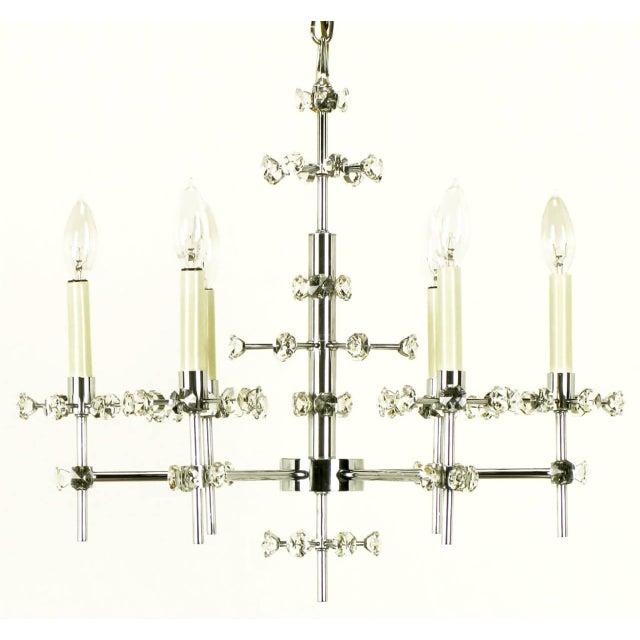 Gaetano Sciolari designed unusual chrome six-arm chandelier with orbital crystal details that extend from the risers and...