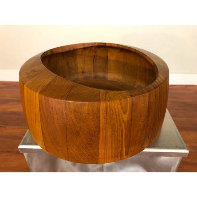 A staved teak bowl made by Jens Quistgaard for Dansk. Quistgaard's work for Dansk is some of the most iconic to come out...