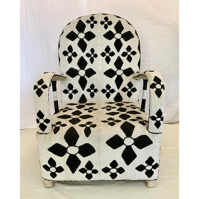 These beautiful & bold chairs are hand made with thousands and thousands of tiny beads by the Yoruba. The Yoruba are an...