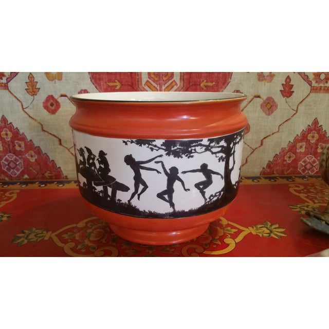 An art deco jardiniere made by Myott and sons. Decorated with silhouette fairy and elf design. England circa 1920