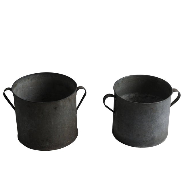 A pair of round vintage pots made of galvanized metal with lateral handles. circa 1950 Arles, France. Slight difference in...