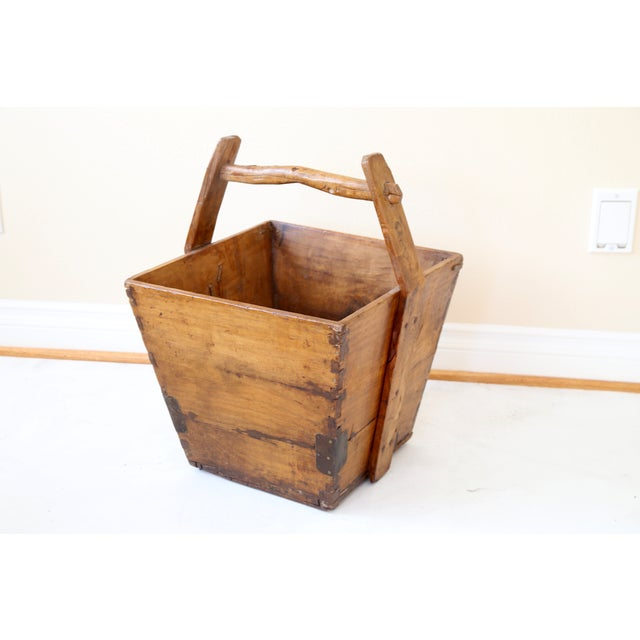 """Beautiful Chinese water bucket constructed in hardwood with sturdy handle. Bucket, 13""""D. Great for wood by the fireplace,..."""