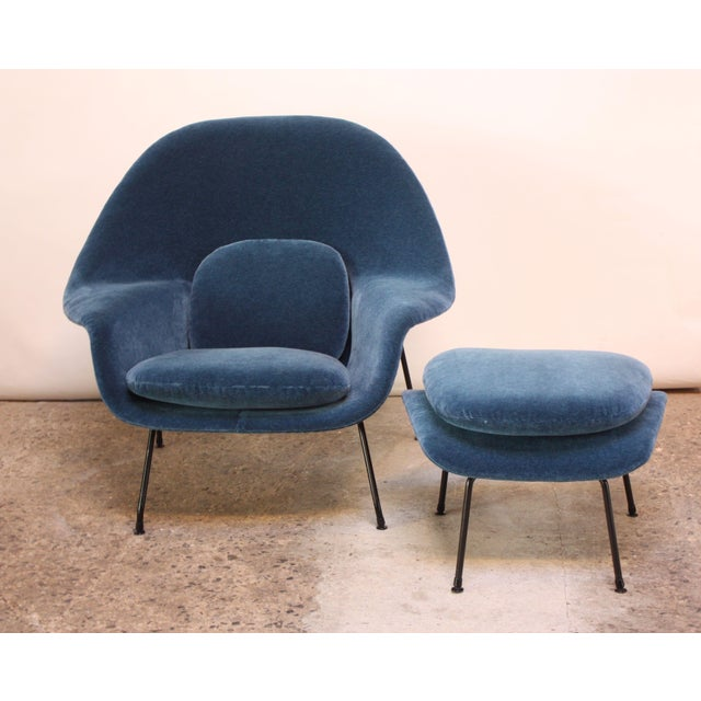 Iconic, early example (circa 1950/51) 'Womb' chair by Saarinen for Knoll. Newly recovered in blue mohair. Bent-wrought...