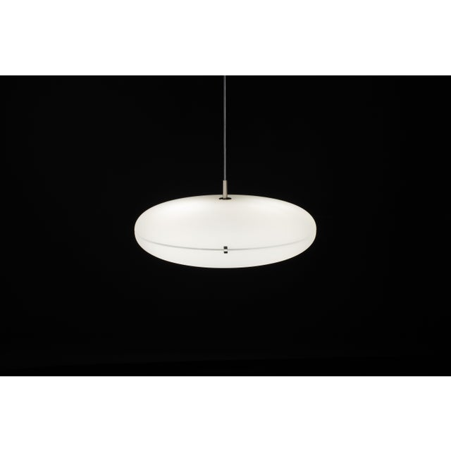 Gio Ponti Luna suspension lamp in nickel. Designed by Italian design icon Gio Ponti, this authorized Tato Italia re-...