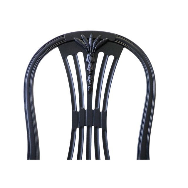 """A pair of Swedish hand carved 'Ax' chairs in a matt black finish and dark cotton upholstered seat. Width: 48cm / 19""""..."""