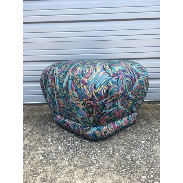 This ottoman features a beautiful polished cotton abstract fabric that will ad a splash of 1980s Miami Vice flair to any...