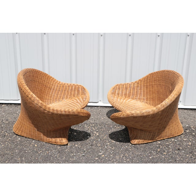 Curvaceous low wicker chairs; one part Om, one part mid-century mod. These broad woven chairs are a sturdy, tranquil spot...