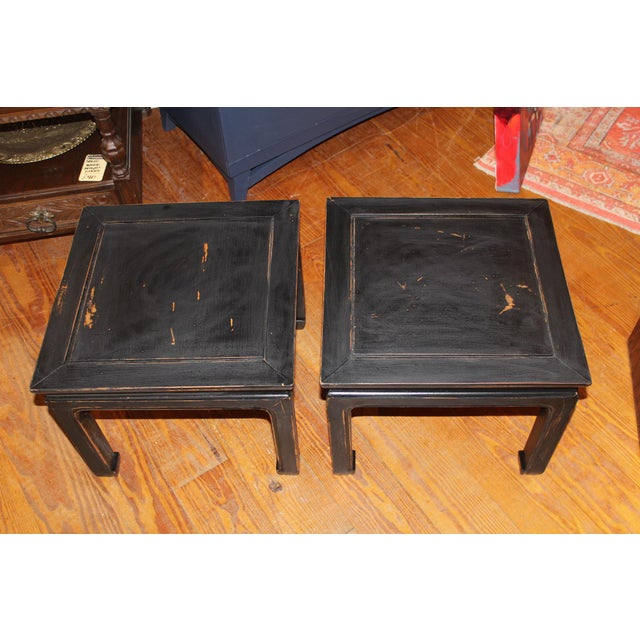 Pair of vintage black Chinese end or small tea table. Each measures 18 inches x 18 inches and 15 inches tall. Good...