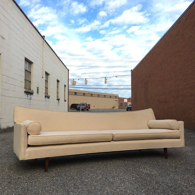 """Beautiful 8 foot long sofa designed by Paul McCobb circa 1950s. This """"Pagoda"""" style sofa features an elegant swooped back,..."""