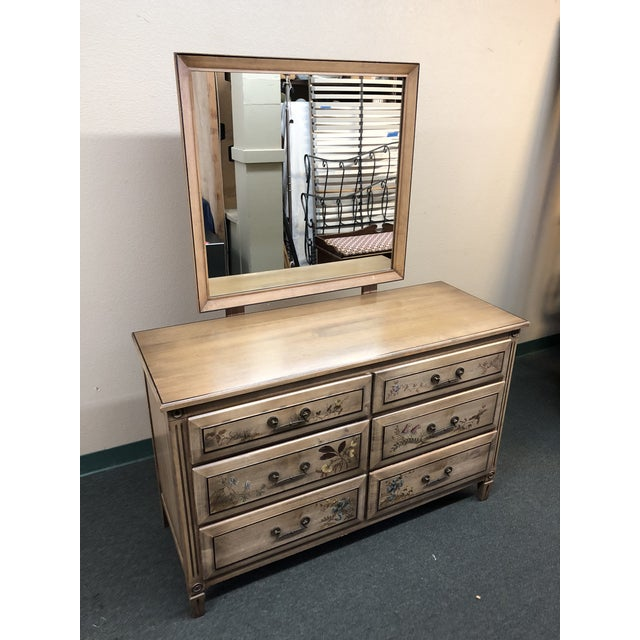 Design Plus Gallery presents a vintage dresser from Herald Furniture of Jamestown New York. The light finish allows the...