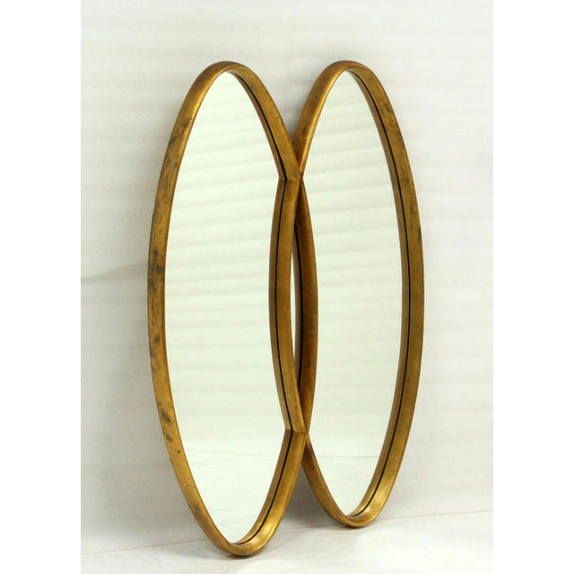 Double overlapping oval mid century modern wall mirror. Fine craftsmanship real wood frames.