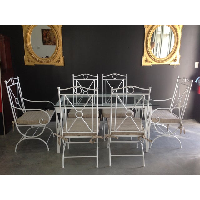 Handmade wrought iron white dining table and six chairs. 1 table and top ( H30 W54.5 D27 -TOP 63x35.5) 2 armchairs (H43.5...