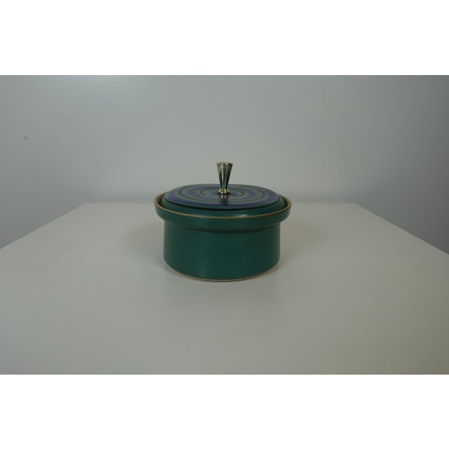 This crock with a lid is by David Gil for Bennington Pottery. It has beautiful colors. Teal blue with purple and light...