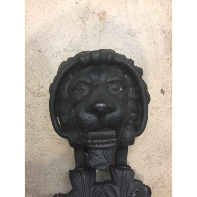 ]A magnificent solid cast iron lion figurine door knocker. It's heavy and the real deal. It has been painted black. Very...