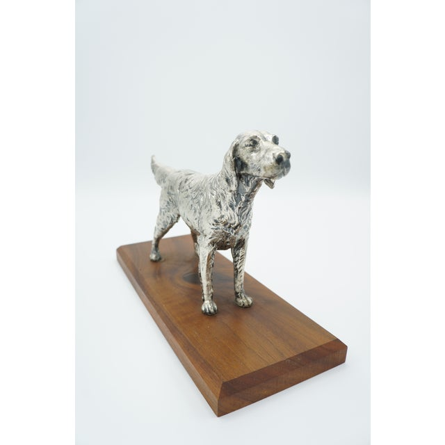 Well executed sporting dog on stained wooden base, either a spaniel or setter. It would make a stately addition to an...