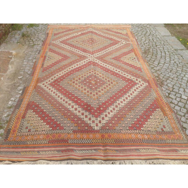 This Anatolian Rug was woven in the Anatolian region of Turkey in the mid 1900's. This unique vintage rug has a beautiful...