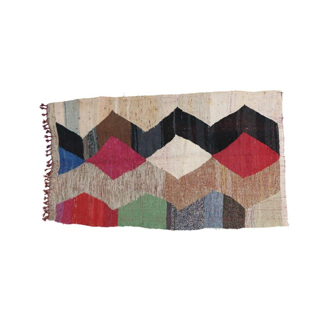 Kilim Boucherouite rugs are colorful flat-weave, one-of-a-kind rag rugs - made of recycled remnants of fabric - but in the...