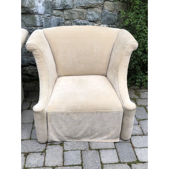 "Pair neutral upholstered oversized club chairs. They are super comfortable. 41-1/2"" W x 32-3/4' H x 31"" max depth. Floor..."
