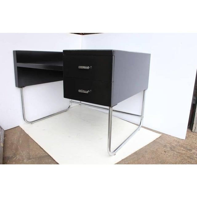 Art Deco black lacquered desk by Wolfgang Hoffmann. This desk is newly restored.