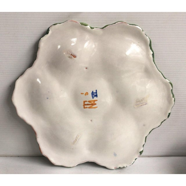 French Faience Rustic Oyster Plate Moustiers Style Circa 1940. Painting of flowers and bird on the center.