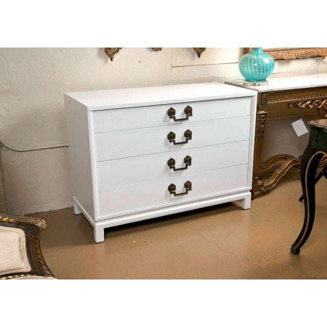 Landstrom custom quality bachelor chest. Bracket feet support this fine white paint decorated commode with graduating...