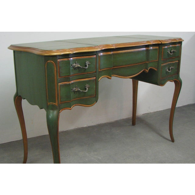 Vintage vanity table or writing desk painted in a rich, antique, green. Antiqued gold paint on all the trim details. The...