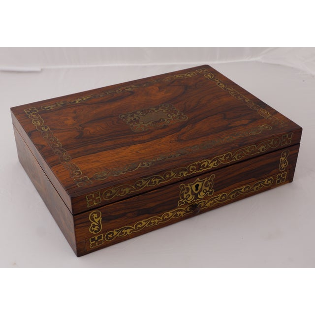 This 19th Century brass inlaid rosewood artist's paint box is a rare item to find. With beautiful inlay work and a hidden...