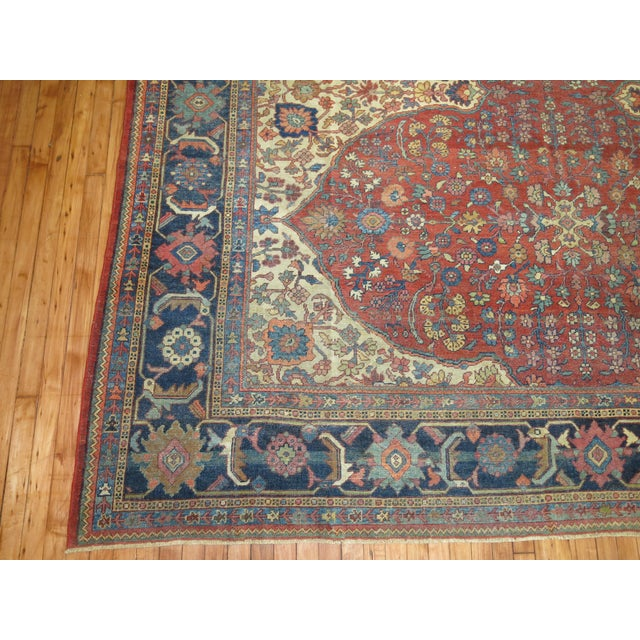 A 19th Century room size Persian Sultanabad Rug with an all-over design on a red field. Professionally Cleaned and able to...