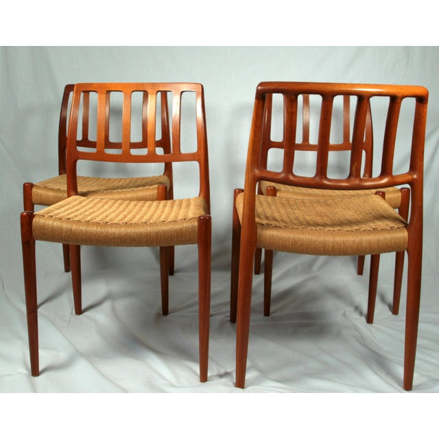 This set of four model 83 dining chairs was designed by Niels O. Møller in 1970's. Chairs have a gorgeous solid Teak...