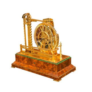 A Gilt Brass Waterwheel Timepiece by Peter Bonnert For Sale