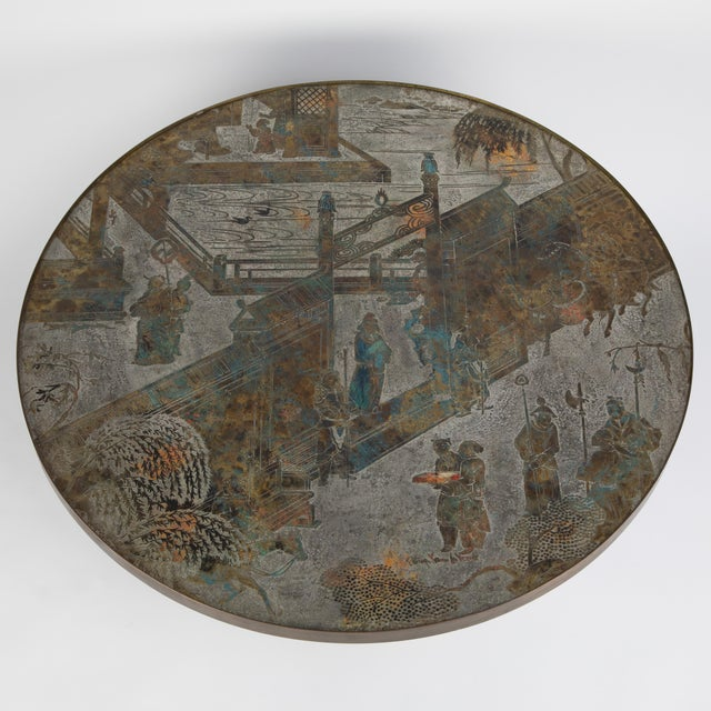 "Signed Philip and Kelvin LaVerne ""Chan"" model No. 142 coffee table featuring a circular acid-etched top of patinated..."