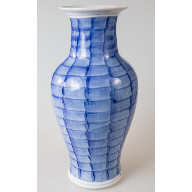 Lovely Chinese porcelain vase hand painted with a cherry blossom floral motif in cobalt blue and white. Signed on reverse....