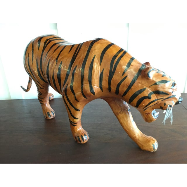 Vintage medium scale leather bound tiger sculpture. From the 1970's, features a leather body with beautiful detail. In...
