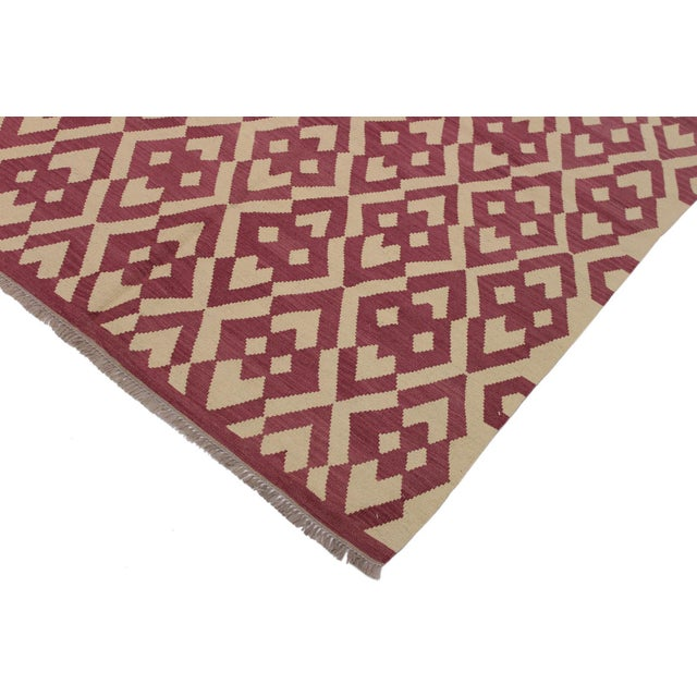 """Add a touch of elegance to your home with this casual chic hand woven Tribal Kilim Hand-Woven Wool Rug. Constructed on a..."