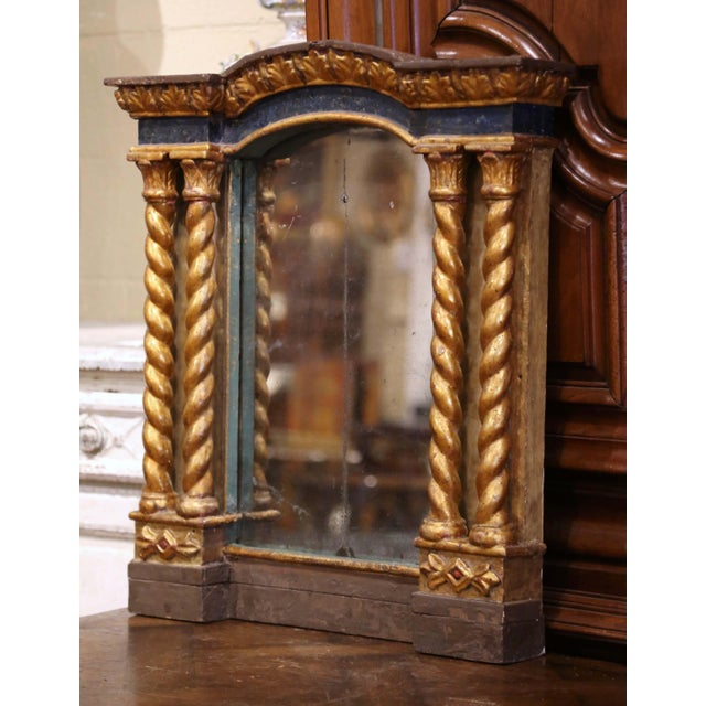 Add a dose of Baroque drama to your home with this elegant antique gilt and painted mirror! Crafted in Italy, circa 1760,...