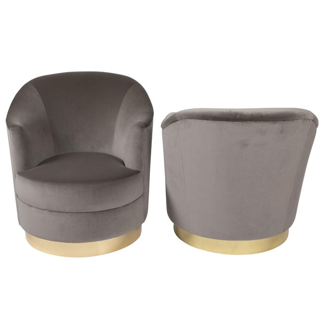 Chic pair of sloped-arm swivel chairs featuring Karl Springer's signature quality of construction. This pair has been...