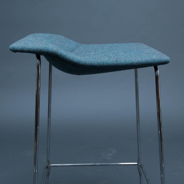 Trivalent chrome-plated flexible steel rod base. Shaped seats in fabric feature saddle stitch detail. Seat hight 30.5