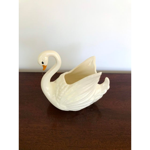Lovely vintage swan flower pot or vase. Ceramic with a simply painted face. There is a small spot with missing glaze along...