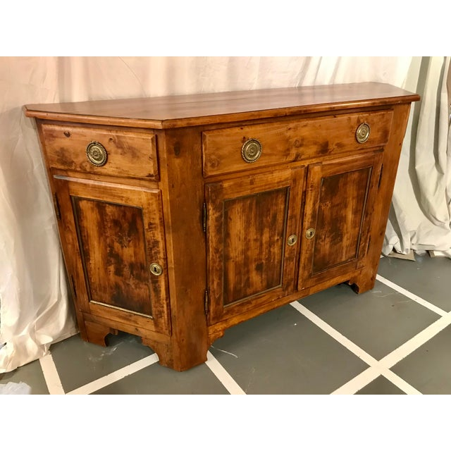 In my nearly twenty years in the business I have never seen a trapezoidal buffet like this, I loved it and bought it!...