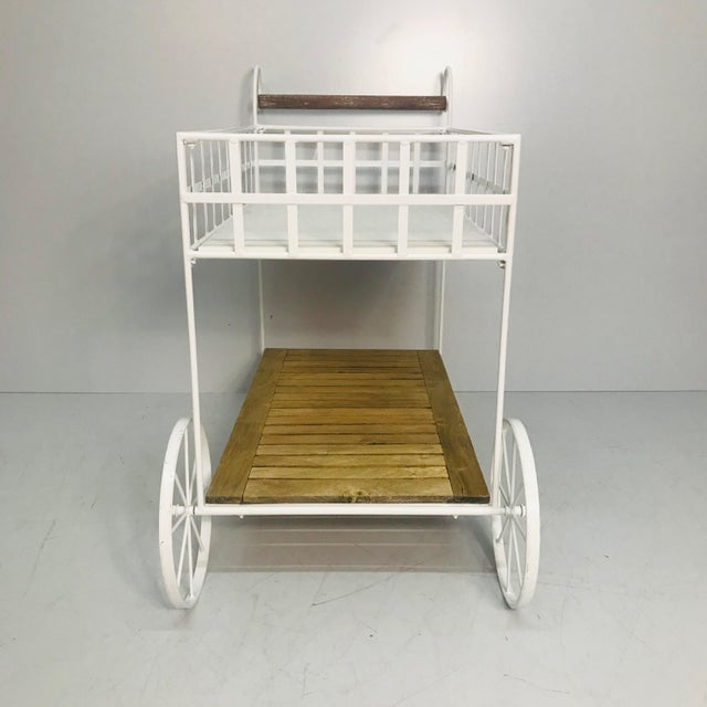 White metal bar cart with teak & stone and functioning wheels. Made in the 1970s.