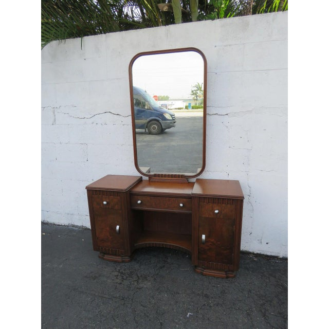 This wonderful Art Deco Set includes a vanity/writing desk, mirror, and chair. The pieces are made out of wood, solid...