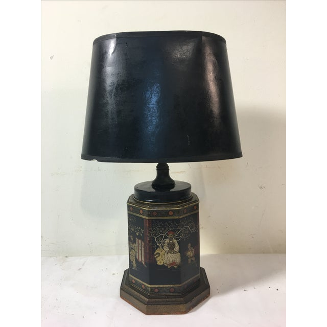 A beautiful, English Tole Chinoiserie tea canister has been mounted on a base and topped with a black paper shade and...