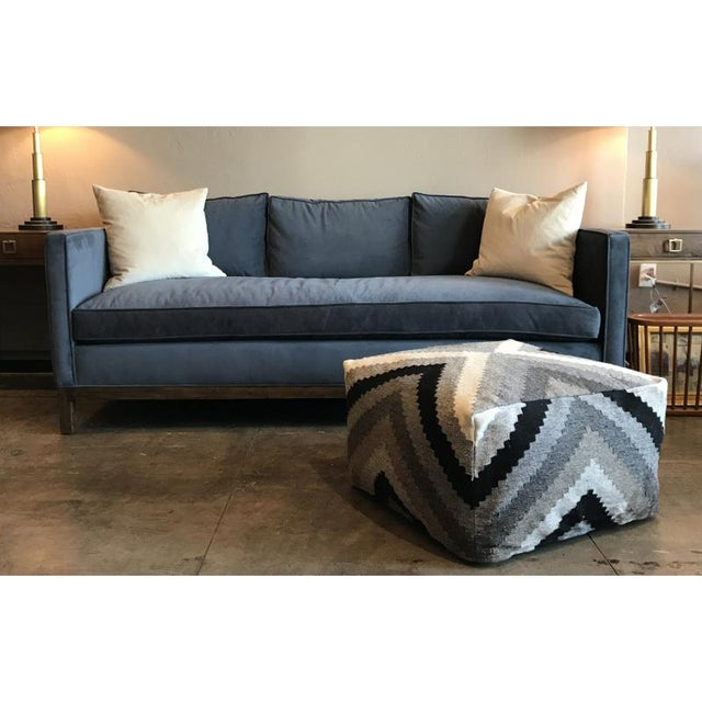 Deep and cozy Evansville sofa by Empiric. Kiln dried Alder frame upholstered in Velveteen Fog Blue. Feather and Down fill....