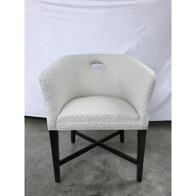 The Bristol Tub Chair is a first quality showroom sample that features a light beige fabric with a city dark finish.