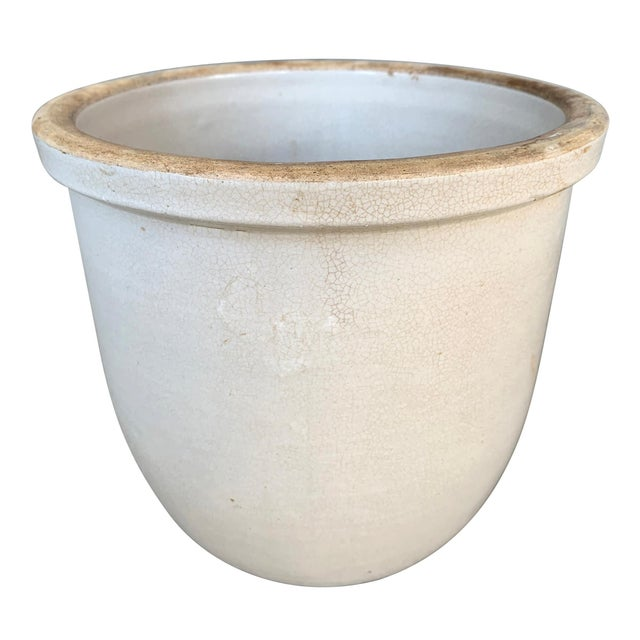 An interesting 19th century American zinc glazed pot with a thick rim, a slightly rounded base, and a wonderful crackled...