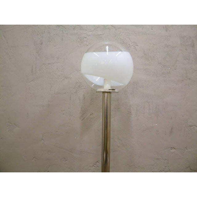 Italy 1960 An architectural chrome and glass floor lamp made in Italy in the 1960s, attributed to Mazzega. The large glass...