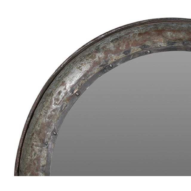 Hand hammered metal round mirror with rivet detail. Each unique in exact finish.