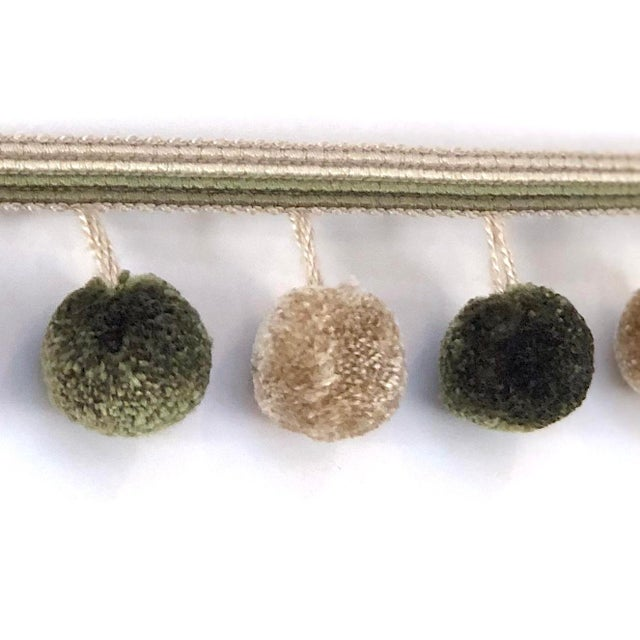 6.75 yards of alternating colored pompom tassel fringe in olive/green & camel. The decorative header has an ombré of a...